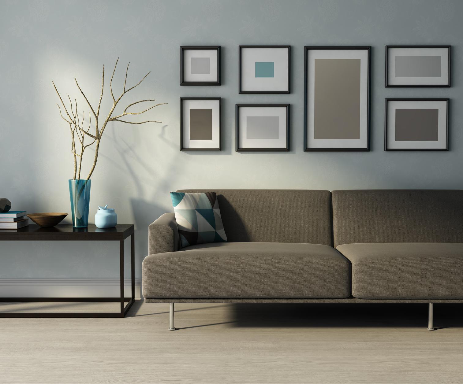 客厅与现代室内,米色沙发,框架和一张桌子在俯瞰bbin出租