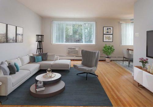 宾夕法尼亚州费城Eola公园bbin的起居室,有沙发、椅子和电视